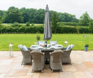 Maze Rattan Oxford 6 Seat Oval Ice Bucket Dining Set with Rounded Chairs & Lazy Susan With a Parasol
