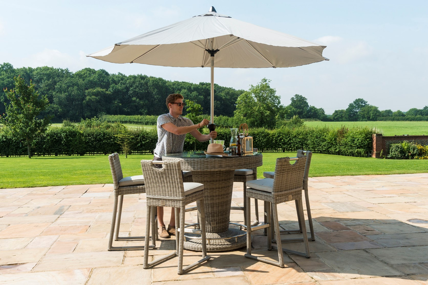 Maze Rattan 6 Seat Round Garden Furniture Bar Set With a luxury inset ice bucket